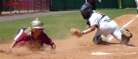 Natasha Jacob slides in safely against Virginia